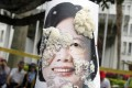 A person wearing a photo of Taiwan's President Tsai Ing-wen is covered by bean curd during a Labour Day rally in Taipei. Beijing has frosty relations with Tsai, suspecting that she wants formal independence for Taiwan.
