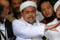 Leader of the Islamic Defenders Forum (FPI) Habib Rizieq (centre). Photo: Reuters