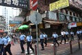 Police investigating a fight involving South Asian Men in Yau Ma Tei last October. Photo: Sam Tsang