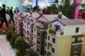Models of residential buildings are seen during an overseas property exposition in Beijing in April. Prices and transactions of second-hand residential property plunged in May, as the government's curbs took effect. Photo: Reuters