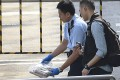 Police remove a fake bomb after a robot checked and detonated the device in a controlled explosion outside Harbour City in Tsim Sha Tsui. Photo: Dickson Lee