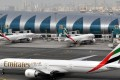 Emirates sent an email to staff on Tuesday telling them to remove the pins. Photo: AP