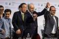 Executive secretary of the UN Framework Convention on Climate Change, Christiana Figueres, then UN secretary-general Ban Ki-moon, French foreign minister Laurent Fabius and president Francois Hollande celebrate after the adoption of the final agreement at the World Climate Change Conference near Paris on December 12, 2015. Photo: EPA