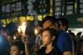 People hold candles up during the June 4th Candle Light Vigil in Victoria Park. Photo: Sam Tsang