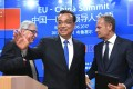 Chinese Prime Minister Li Keqiang (centre), European Commission President Jean-Claude Juncker (left) and European Council President Donald Tusk leave after addressing a press conference at the end of the EU-China summit in Brussels on Friday. Photo: AFP