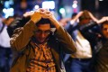 People leave the area with their hands up after an incident near London Bridge. Photo: Reuters