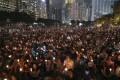 Candles aloft at Victoria Park. Photo: Robert Ng