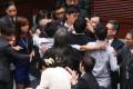 Yau Wai-ching (blue dress) and Sixtus Baggio Leung Chung-hang try to enter the November meeting. Photo: K. Y. Cheng