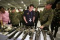 Philippine President Rodrigo Duterte looks at rifles on display during his visit to a military camp. Philippine opposition lawmakers on Monday asked the Supreme Court to reject Duterte's imposition of martial law in the south of the country, branding it unconstitutional. Photo: EPA