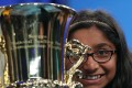 "Twelve-year-old Ananya Vinay of Fresno, California, holds her trophy after winning the 2017 Scripps National Spelling Bee by spelling the word ""marocain"" 7 in National Harbor, Maryland. Photo: AFP"