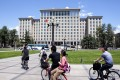 Students cycling past the central main building on campus at Tsinghua University in Beijing, China. Photo: SCMP Pictures