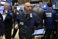 Trader Vincent Napolitano, centre, hustles across the floor of the New York Stock Exchange as stocks slipped while waiting for the testimony of former FBI director James Comey and the results of the UK election on Thursday. Photo: AP