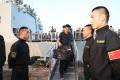 PLA sailors escort Chinese evacuees from war-torn Yemen upon arrival in Djibouti, in 2015. China's construction of a naval logistics centre in Djibouti is being seen by the Pentagon as part of a worldwide expansion. Photo: Xinhua