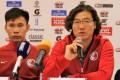 Kim Pan-gon (right) and Hong Kong captain Yapp Hung-fai Photo: HKFA