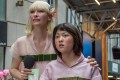 Tilda Swinton and Ahn Seo-hyun as Mija in Okja.