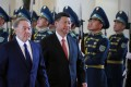 Kazakh president Nursultan Nazarbayev and China's Xi Jinping review the honour guard during a welcoming ceremony before their meeting as part of the Shanghai Cooperation Organisation in Astana. Photo: Reuters