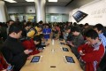 Chinese customers look at Apple products in Apple's Wangfujing shopping district store in Beijing. Chinese authorities say they have uncovered a massive underground operation run by Apple employees selling computer and phone users' personal data. Photo: EPA