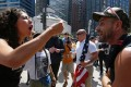 "A pro-Muslim supporter argues with a demonstrator with the ""March Against Sharia"" protest in Chicago, Illinois. Photo: AFP"