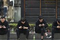 People browse their smartphones in Beijing. Jefferies predicts the mainland will have 588 million 5G subscribers by 2022. Photo: AP