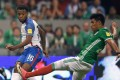 USA's Kellyn Acosta is challenged by Mexico's Jesus Gallardo during their 2018 World Cup qualifier draw. Photo: AFP