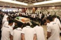 Beijing Enterprises players mourn for Cheick Tiote at his funeral at the Babaoshan funeral centre in Beijing. Photo: Xinhua