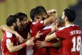 Ahmad Al Salih (second right) celebrates with teammates after scoring an equaliser against China. Photo: Reuters