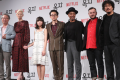 """Actors of the film """"Okja,"""" directed by Bong Joon-ho, pose during a press conference at the Four Seasons Seoul, Wednesday. From left are Byun Hee-bong, Tilda Swinton, Ahn Seo-hyun, Steven Yeun, Giancarlo Esposito, Daniel Henshall and Bong. Photo: Yonhap"""