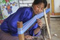 Bhutanese weaver Pema Laatchi, who makes scarves for ANA by Karma.