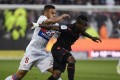 Nice's Ivorian midfielder Jean Michael Seri (R) vies with Lyon's French midfielder Coretin Tolisso (L) during the French L1 football match between Lyon (OL) and Nice (OGCN). Tolisso is going to play for Bayern Munich in a record transfer for the Bundesliga. Photo: