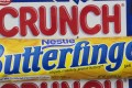 A Nestle Butterfinger and Crunch candy bars are arranged for a photo in New York. On Thursday, June 15, 2017, Nestle said it's considering a sale of its US candy business. The unit includes brands like Butterfinger, Baby Ruth, 100 Grand, Skinny Cow and Raisinets. Photo: AP