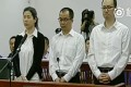 The three employees, Yang Ying (left), Xie Honglin (centre) and Lu Tao pictured during an earlier court hearing in Dalian. Photo: Handout