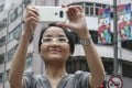 WYNG Foundation CEO Yip Yan-yan shoots a video in Hong Kong. She wants others to share their work in the contest. Photo: Nora Tam