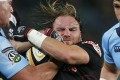 Andy Goode played for numerous clubs, including the Natal Sharks, as well as England. Picture carrying the ball into contact for . Photo: Reuters