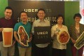 Horace Lam, general manager of UberEats (centre), surrounded by local food vendors who have signed up for the company's delivery services. Photo: Handout