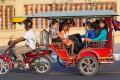 A family travels via tuk-tuk in Phnom Penh, Cambodia. Handout photo