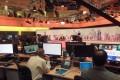 Staff members of Al-Jazeera International work at the news studio in Doha, Qatar. Photo: Reuters