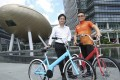 Chief operating officer of Cleantech, Parkson Yip (left) and partner Bryan Au from Xiao Sun Bike hope to combine services to tap into the growing bike-sharing market. Photo: Edmond So