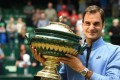 Switzerland's Roger Federer poses with his trophy after winning his final match against Alexander Zverev. Photo: AFP