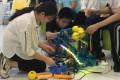 Teammates make final adjustments to their robot at Makeblock's makeathon in Shenzhen, China, Photo: Coco Liu