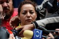 Frida Urtiz, wife of reporter Salvador Adame Pardo, speaks to the media during a protest against the May 18 disappearance of her husband. His burned remains have been identified by the authorities. Photo: Reuters