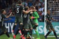 Germany players celebrate with goalkeeper Julian Pollersbeck after he saves the penalty that put his team in the final of the under-21 European Championship. Photo: AFP