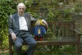 Author Michael Bond sits with a Paddington Bear toy. Photo: AP