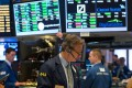 Traders file their orders at the closing bell of the Dow Jones Industrial Average at the New York Stock Exchange on June 28, 2017 in New York. Financial and technology stocks led a broad market rally. Photo: AFP