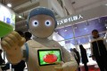 A robot performs at a conference in Beijing. Photo: Simon Song