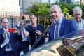 British Columbia Premier-designate John Horgan gets into his car after making a statement to the media at Government House following a non-confidence vote in Victoria on Thursday. Photo: Reuters