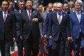 President Xi Jinping and his Russian counterpart Vladimir Putin arrive with other leaders for a group photo during the Belt and Road Forum in Beijing, on May 15. Photo: AFP
