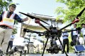 A drone used by an architectural office to capture images of the rooftop and walls of a turret at Osaka Castle, with the aim of offering renovation services for cultural assets. Photo: Kyodo