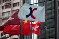 The flag of the Hong Kong Exchanges and Clearing flies outside the bourse in Hong Kong. Photo: EPA