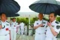 Admiral Wu Shengli (second right), then commander of the PLA Navy, holds an umbrella for Real Admiral Ma Weiming at the PLA Naval University of Engineering in Wuhan in June, 2016 . Photo: Handout