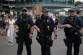 Armed British Police officers patrol at The All England Lawn Tennis Club in Wimbledon, as security was increased following a string of terrorist attacks. Photo: AFP
